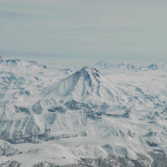 View from aircraft. From left to right: Mutnovsky, Viluchinsky, Asacha and Gorely volcanoes. Khodutka volcano far away.
