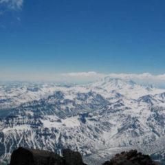 Mid-June, Viluchinsky volcano. Panorama from the summit: Pacific Ocean, Mutnovsky and Gorely volcanoes.