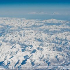 Sredinny Range from aircraft. Kluchevskaya group of volcanoes far away.